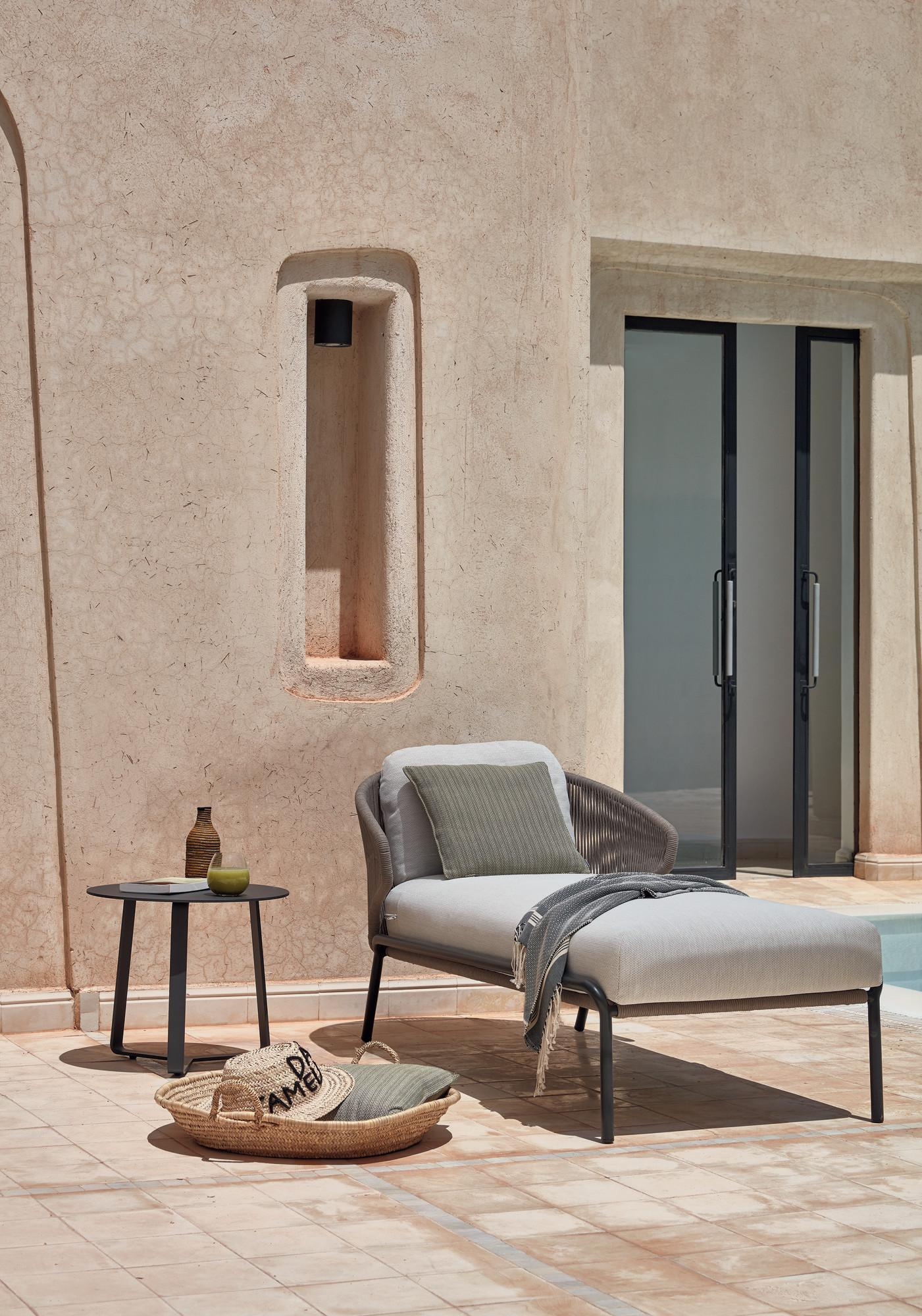Radius lounger with side table on small terrace