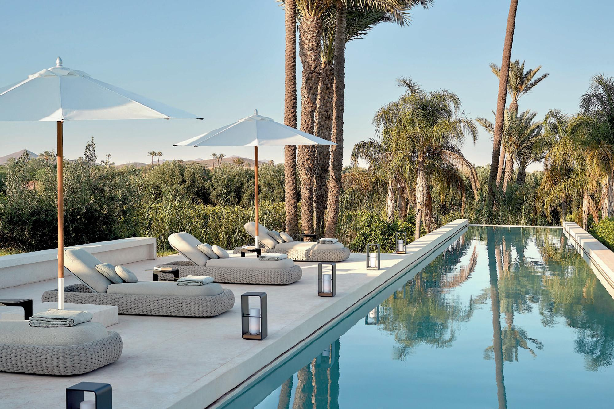 Kobo loungers, umbrellas and Flame Lumo by the pool