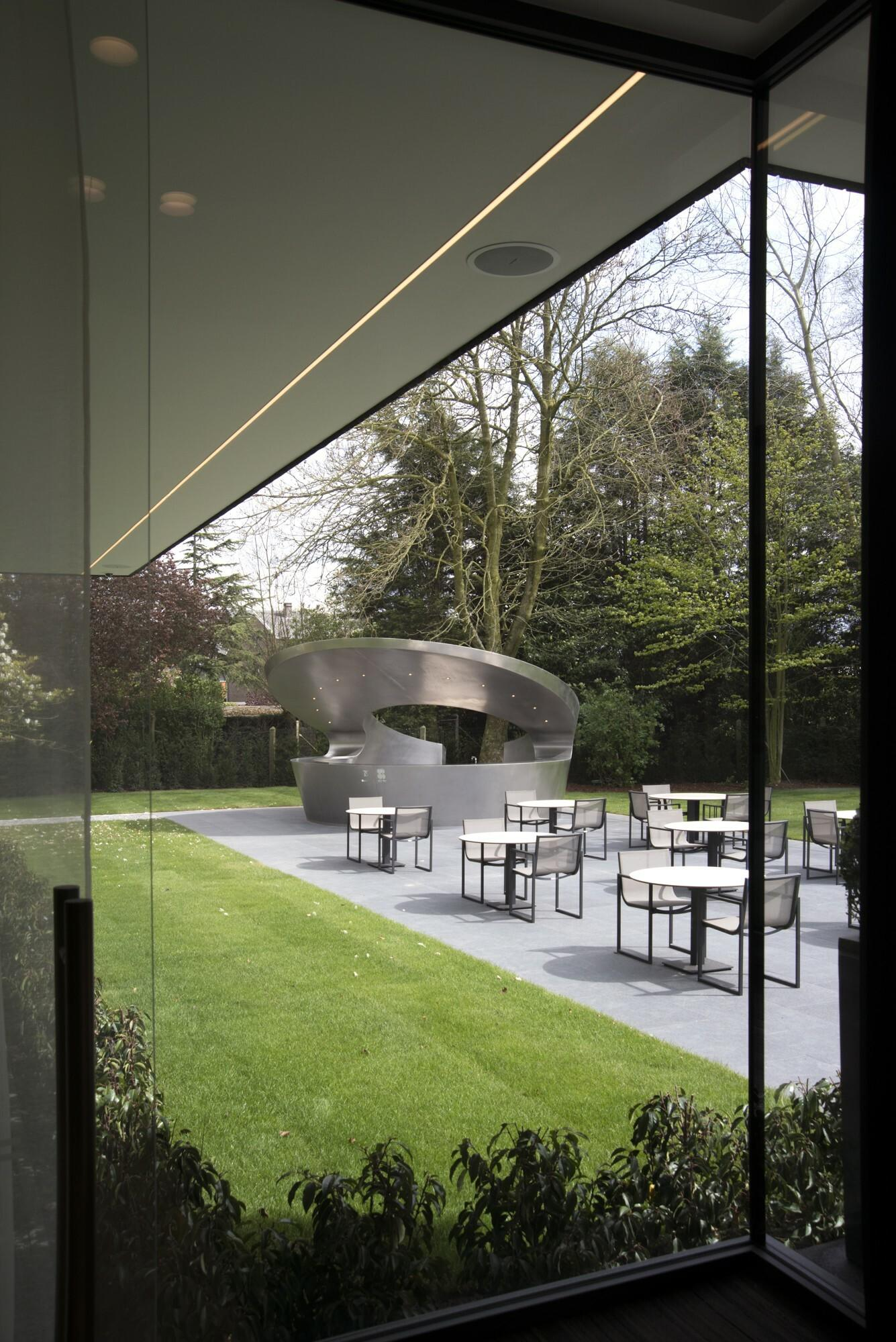 Patio with outdoor furniture and bar